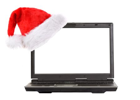 christmas laptop with a hat on the screen over white