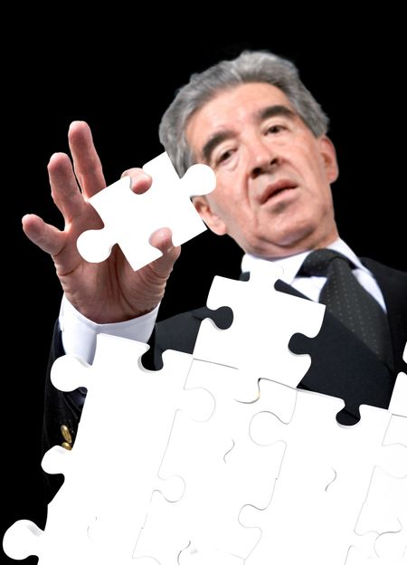 business man solving a puzzle over a black background
