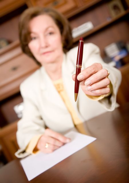 business woman offering her pen to seal the deal