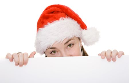 christmas woman peeping over a white card