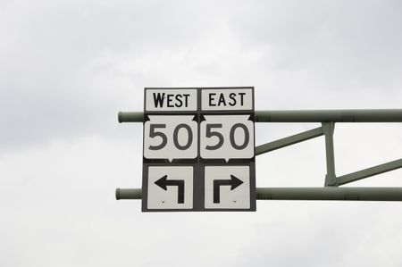 Street sign: turn left? turn right? Decisions, decisions . . . Main Street, Lake Geneva, Wisconsin, June 2008