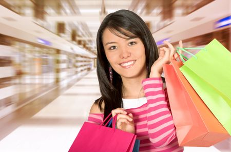 beautiful girl with her shopping bags in a shopping centre