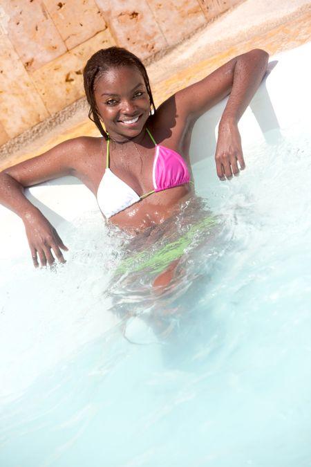 beautiful black woman by a swimming pool
