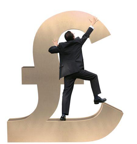 business man climbing a british pound sign