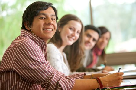 Group of college university students smiling in a classroom