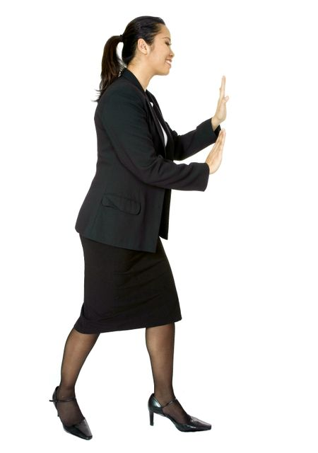 asian business woman pushing something aside over a white background