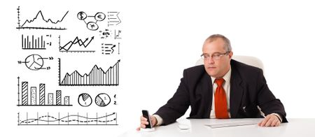 Businessman sitting at desk with diagrams and graphs, isolated on white