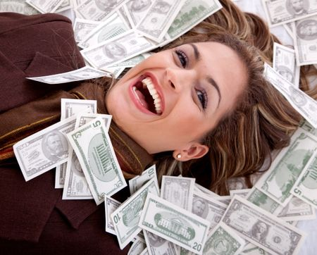 Business woman millionaire with money around her face | Freestock photos