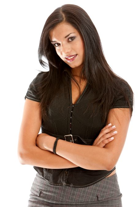 Businesswoman standing with her arms crossed isolated over white