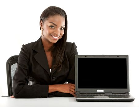 Business woman smiling with laptop isolated over a white background