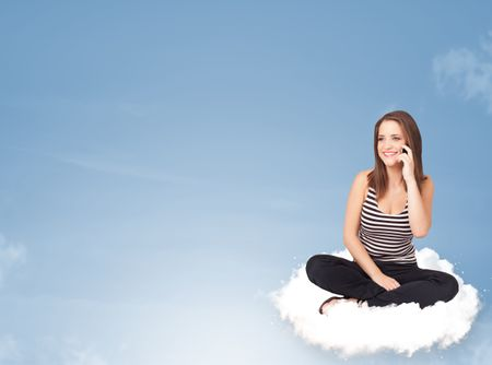 Beautiful young woman sitting on cloud with copy space