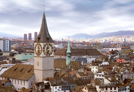zurich skyline with the clock tower in the foreground