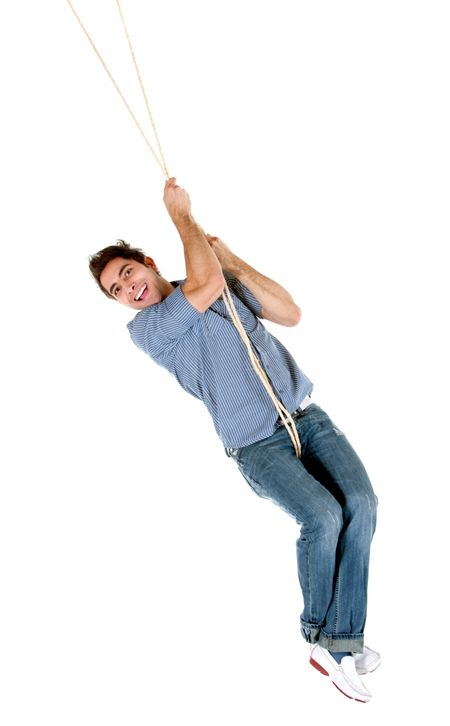 Casual man jumping with a rope isolated over a white background