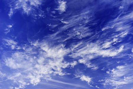 Winter sky: Wispy cirrus clouds tattered by high winds late in December, northern Illinois, USA