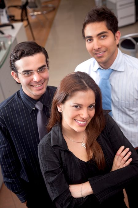 Business partners standing at an office smiling