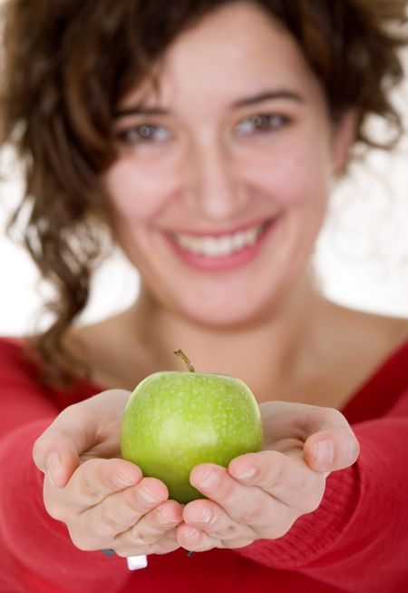 girl on a healthy diet smiling - focus is on apple ...