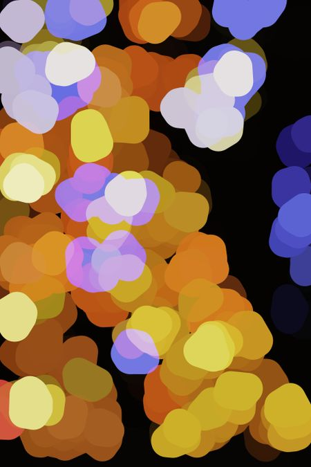 Multicolored abstract of large, glowing, blobby holiday lights, overlapping for 3-D effect, on black