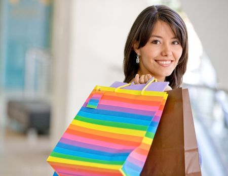 Shopping woman carrying some bags at a mall
