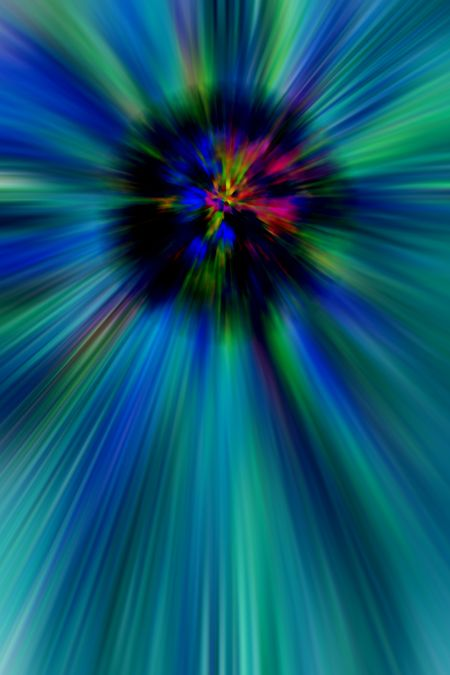 Abstract of a stellar explosion or black hole in a multicolored field with radial blur, for scientific and speculative themes