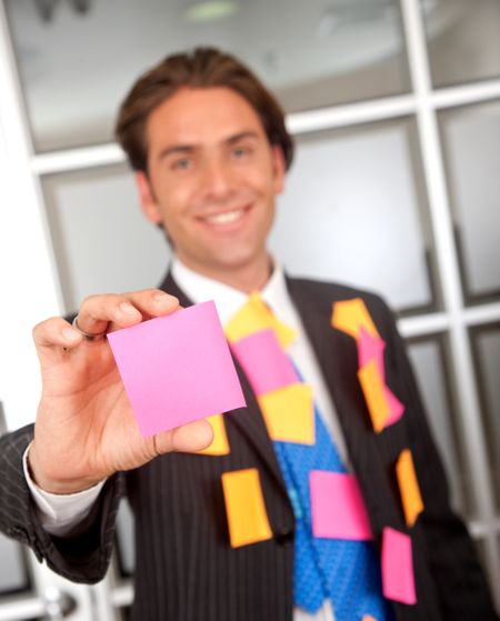 businessman cover with post its at an office