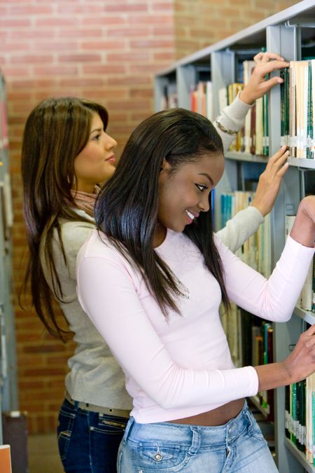 college students in a library looking for a book