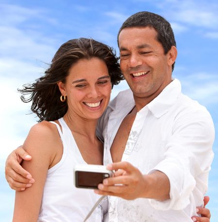 Couple with a digital camera taking an auto photo