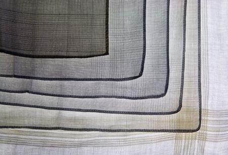 Pattern of men's handkerchiefs one on top of another