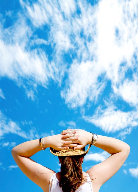 girl relaxing outdoors in front of a beautiful blue sky