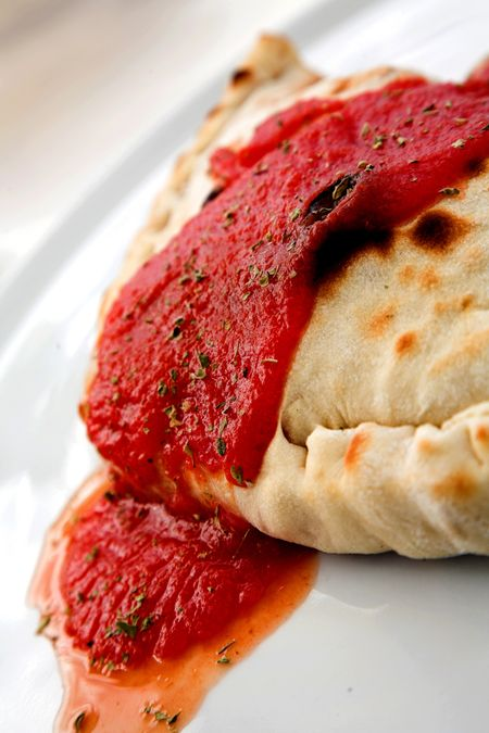 delicious italian dish - calzone on a plate