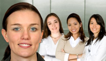 beautiful business woman and her team in an office - female only