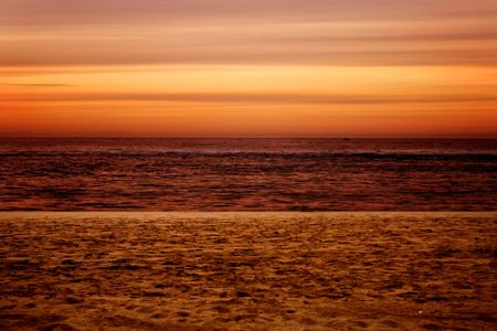 beautiful sunset by the beach in orange colours