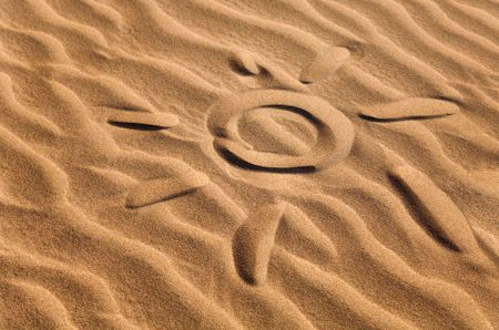 sun shape on a sandy beach