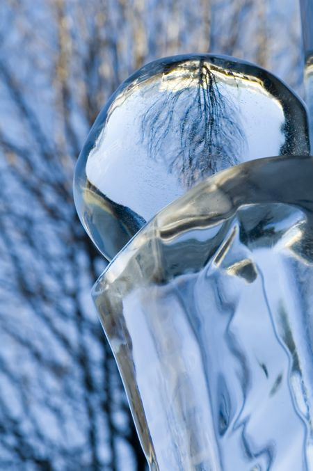 Close-up of ice pedestal and reflective ball