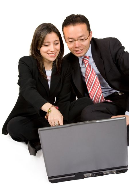 business couple with laptop smiling over a white background