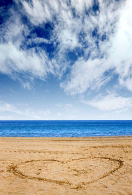 heart shape on the beach with a beautiful blue sky