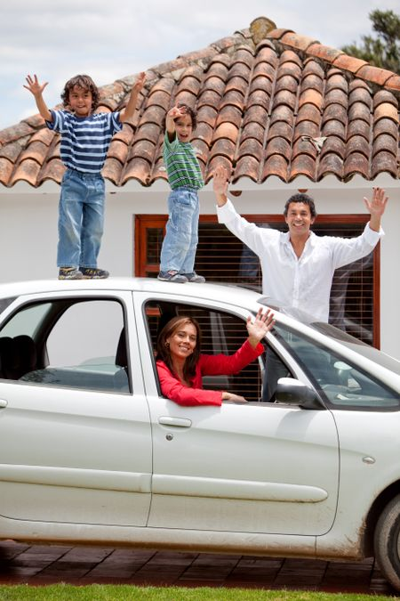 Family standing on top of a car
