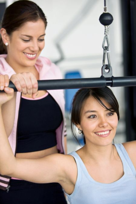 Beautiful girls working out at the gym