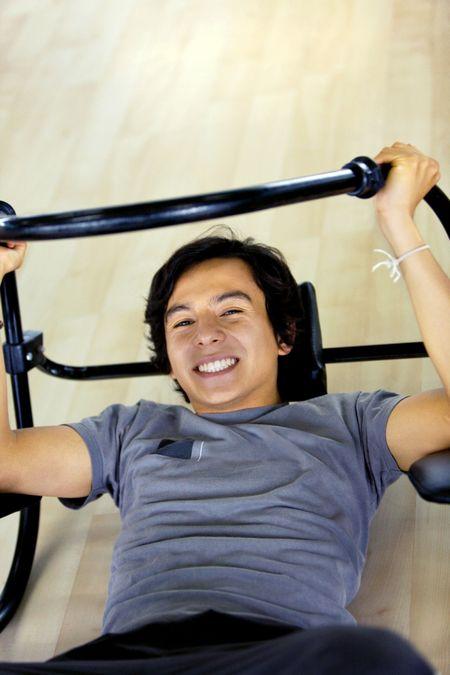 Man at the gym doing sit-ups
