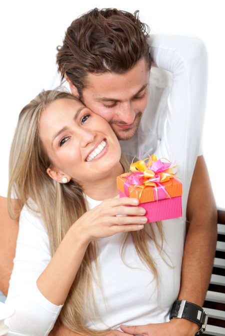 Couple celebrating a special date with a gift