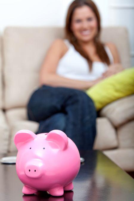 Woman's personal savings in a piggybank