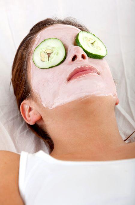 Woman enjoying her facial treatment - beauty concepts