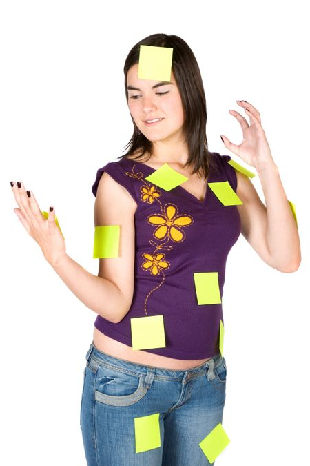busy and stressed woman with lots of things to do - post its over a white background