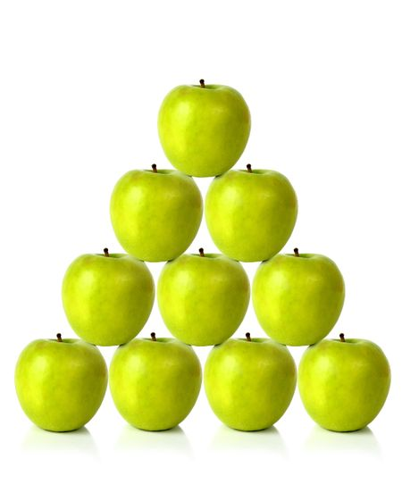 green apples on a pyramid shape over a white background