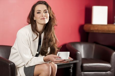 Professional business woman enjoying a fresh coffee