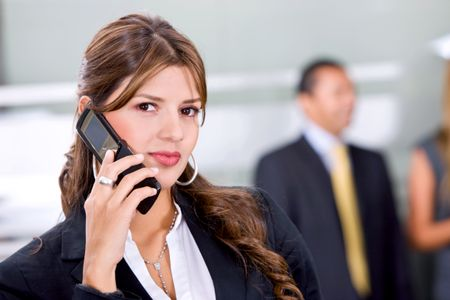 businesswoman talking on the phone in an office