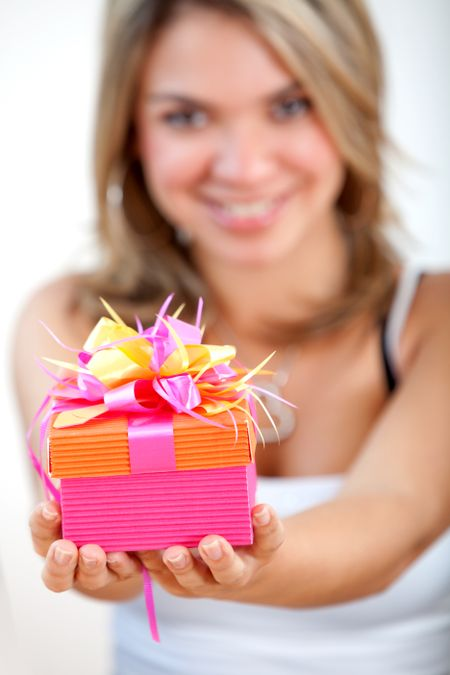 girl holding a gift box - isolated over white