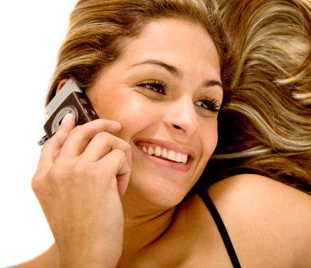 Beautiful woman on the phone isolated