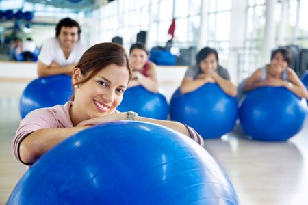 group of gym people at a pilates class