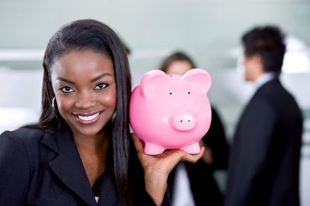 business savings of a woman with a piggy bank