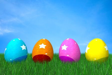 colorful easter eggs on grass in front of a beautiful blue sky